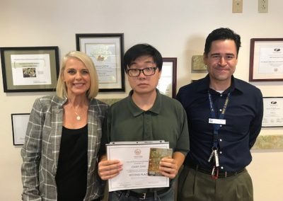 """2nd Place: """"Banned Books Essay"""" by Casey Cho, who wrote about justifications for reading literature works in spite of the author's controversial identity and beliefs using Howard Fast's Citizen Tom Paine, won $100."""